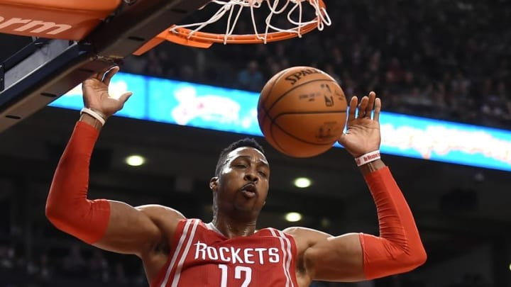 Mar 6, 2016; Toronto, Ontario, CAN; Houston Rockets center Dwight Howard (12) dunks the ball against Toronto Raptors in the second quarter at Air Canada Centre. Mandatory Credit: Dan Hamilton-USA TODAY Sports