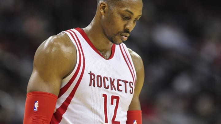 Mar 23, 2016; Houston, TX, USA; Houston Rockets center Dwight Howard (12) reacts after a play during the third quarter against the Utah Jazz at Toyota Center. The Jazz won 89-87. Mandatory Credit: Troy Taormina-USA TODAY Sports