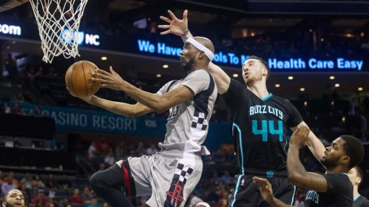 Mar 12, 2016; Charlotte, NC, USA; Houston Rockets forward Corey Brewer (33) goes up for a shot while Charlotte Hornets forward Frank Kaminsky (44) defends in the second half at Time Warner Cable Arena. The Hornets defeated the Rockets 125-109. Mandatory Credit: Jeremy Brevard-USA TODAY Sports
