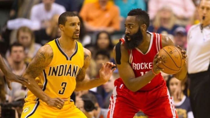 Mar 27, 2016; Indianapolis, IN, USA; Houston Rockets guard James Harden (13) looks to dribble the ball while Indiana Pacers guard George Hill (3) defends in the first half of the game at Bankers Life Fieldhouse. Mandatory Credit: Trevor Ruszkowski-USA TODAY Sports