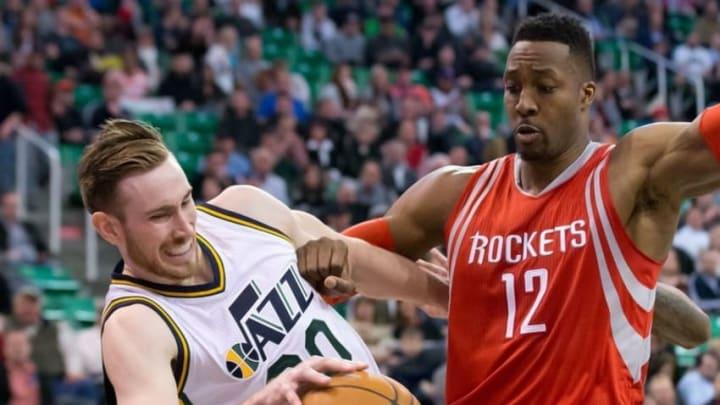 Feb 23, 2016; Salt Lake City, UT, USA; Utah Jazz forward Gordon Hayward (20) is fouled by Houston Rockets center Dwight Howard (12) during overtime at Vivint Smart Home Arena. Utah won 117-114. Mandatory Credit: Russ Isabella-USA TODAY Sports
