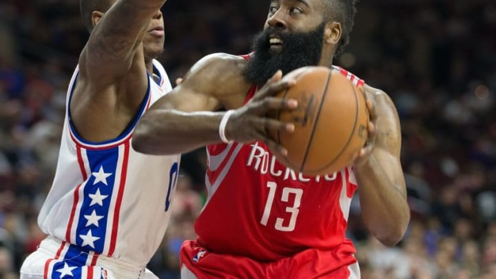 Mar 9, 2016; Philadelphia, PA, USA; Houston Rockets guard James Harden (13) controls the ball as Philadelphia 76ers guard Isaiah Canaan (0) defends during the second quarter at Wells Fargo Center. Mandatory Credit: Bill Streicher-USA TODAY Sports