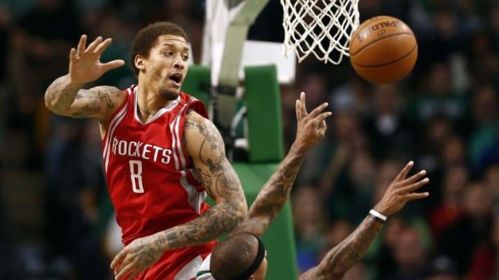 Mar 11, 2016; Boston, MA, USA; Boston Celtics guard Isaiah Thomas (4) shoots the ball against Houston Rockets forward Michael Beasley (8) during the first half at TD Garden. Mandatory Credit: Mark L. Baer-USA TODAY Sports