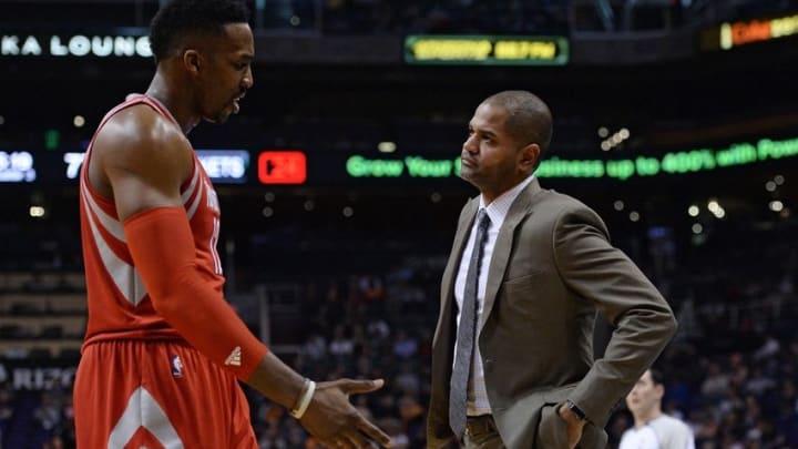 Feb 4, 2016; Phoenix, AZ, USA; Houston Rockets center Dwight Howard (12) talks with head coach J.B. Bickerstaff at Talking Stick Resort Arena. Mandatory Credit: Jennifer Stewart-USA TODAY Sports
