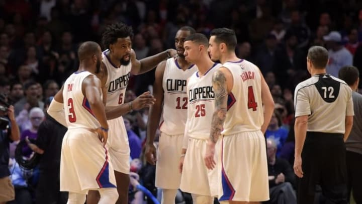 Jan 18, 2016; Los Angeles, CA, USA; Los Angeles Clippers players Chris Paul (3) and DeAndre Jordan (6), forward Luc Richard Mbah a Moute (12) and Austin Rivers (25) and J.J. Redick (4) huddle during an NBA basketball game against the Houston Rockets at Staples Center. The Clippers defeated the Rockers 140-132 in overtime. Mandatory Credit: Kirby Lee-USA TODAY Sports