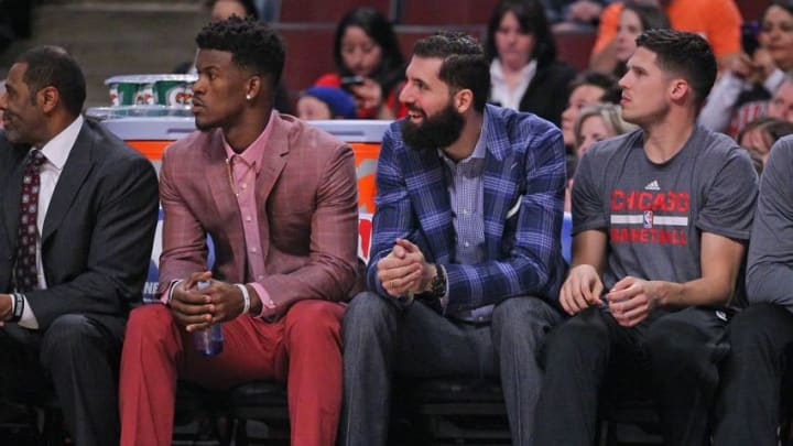 Feb 24, 2016; Chicago, IL, USA; Chicago Bulls guard Jimmy Butler (left) and forward Nikola Mirotic (center) on the bench in street clothes during the first quarter against the Washington Wizards at the United Center. Mandatory Credit: Dennis Wierzbicki-USA TODAY Sports