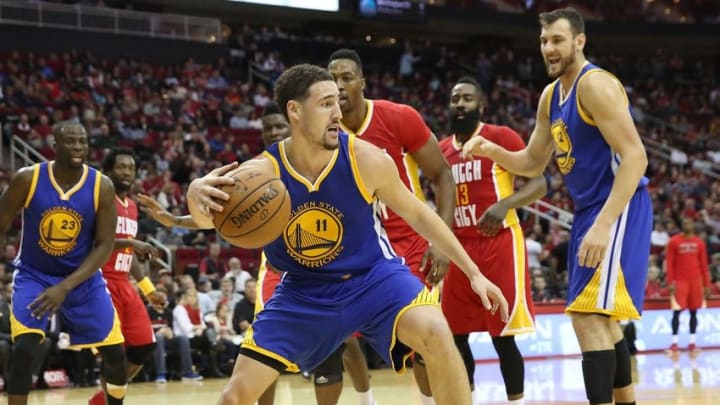 Dec 31, 2015; Houston, TX, USA;Golden State Warriors guard Klay Thompson (11) dribbles against the Houston Rockets in the second half at Toyota Center. The Warriors won 114 to 110. Mandatory Credit: Thomas B. Shea-USA TODAY Sports