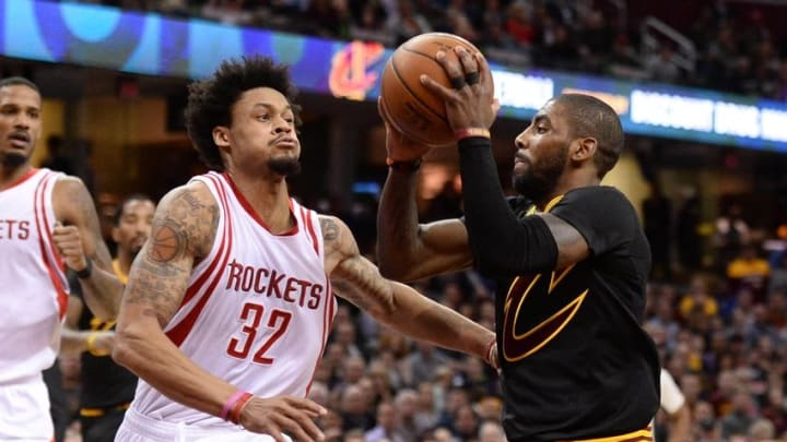 Mar 29, 2016; Cleveland, OH, USA; Cleveland Cavaliers guard Kyrie Irving (2) drives on Houston Rockets guard K.J. McDaniels (32) during the second quarter at Quicken Loans Arena. Mandatory Credit: Ken Blaze-USA TODAY Sports