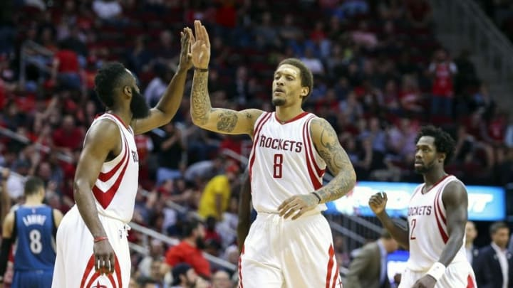 Mar 18, 2016; Houston, TX, USA; Houston Rockets forward Michael Beasley (8) celebrates with guard James Harden (13) after making a basket during the fourth quarter against the Minnesota Timberwolves at Toyota Center. The Rockets won 116-111. Mandatory Credit: Troy Taormina-USA TODAY Sports