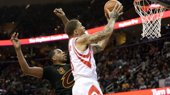 Mar 29, 2016; Cleveland, OH, USA; Houston Rockets forward Michael Beasley (8) drives to the basket as Cleveland Cavaliers center Tristan Thompson (13) defends during the second quarter at Quicken Loans Arena. Mandatory Credit: Ken Blaze-USA TODAY Sports