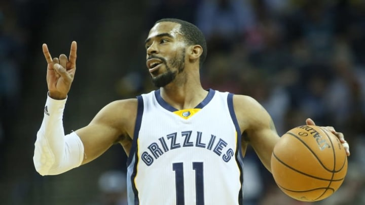 Mar 6, 2016; Memphis, TN, USA; Memphis Grizzlies guard Mike Conley (11) signals to his team as he dribbles in the first quarter against the Phoenix Suns at FedExForum. Mandatory Credit: Nelson Chenault-USA TODAY Sports