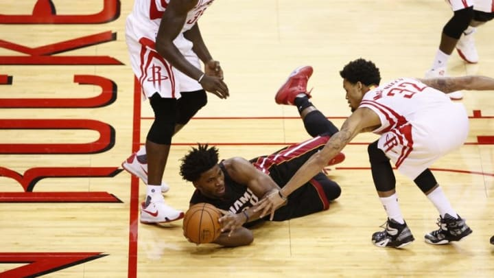 Oct 17, 2015; Houston, TX, USA; Miami Heat small forward Justise Winslow (20) tries to pass as Houston Rockets power forward Montrezl Harrell (35) and shooting guard K.J. McDaniels (32) defend during the second half at Toyota Center. Mandatory Credit: Soobum Im-USA TODAY Sports