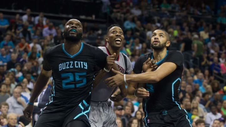 Mar 12, 2016; Charlotte, NC, USA; Charlotte Hornets center Al Jeffereson (25) and forward Nicolas Batum (5) box out Houston Rockets center Dwight Howard (12) in the second half at Time Warner Cable Arena. The Hornets defeated the Rockets 125-109. Mandatory Credit: Jeremy Brevard-USA TODAY Sports
