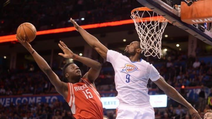 Mar 22, 2016; Oklahoma City, OK, USA; Houston Rockets forward Clint Capela (15) shoots the ball over Oklahoma City Thunder forward Serge Ibaka (9) during the second quarter at Chesapeake Energy Arena. Mandatory Credit: Mark D. Smith-USA TODAY Sports