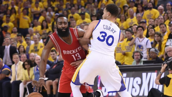 May 27, 2015; Oakland, CA, USA; Houston Rockets guard James Harden (13) dribbles as Golden State Warriors guard Stephen Curry (30) defends during the first half in game five of the Western Conference Finals of the NBA Playoffs. at Oracle Arena. Mandatory Credit: Kyle Terada-USA TODAY Sports