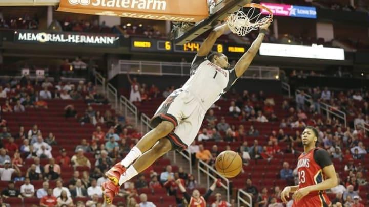 Mar 2, 2016; Houston, TX, USA; Houston Rockets forward Trevor Ariza (1) dunks against New Orleans Pelicans forward Anthony Davis (23) in the first quarter at Toyota Center. Mandatory Credit: Thomas B. Shea-USA TODAY Sports