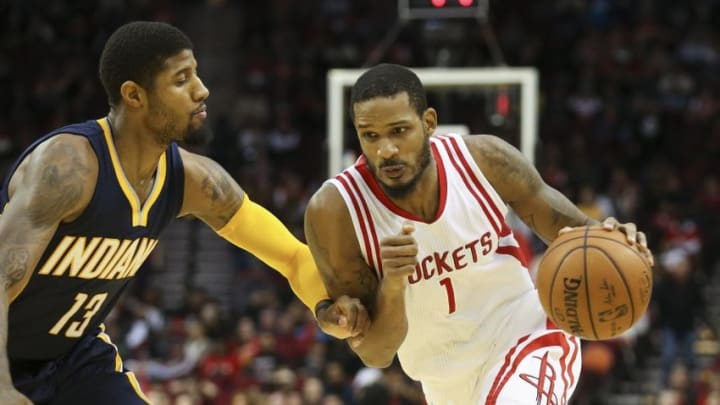 Jan 10, 2016; Houston, TX, USA; Houston Rockets forward Trevor Ariza (1) drives the ball as Indiana Pacers forward Paul George (13) defends in overtime at Toyota Center. Mandatory Credit: Troy Taormina-USA TODAY Sports