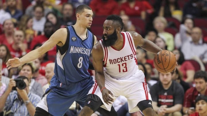 Mar 18, 2016; Houston, TX, USA; Houston Rockets guard James Harden (13) controls the ball as Minnesota Timberwolves guard Zach LaVine (8) defends during the third quarter at Toyota Center. Mandatory Credit: Troy Taormina-USA TODAY Sports