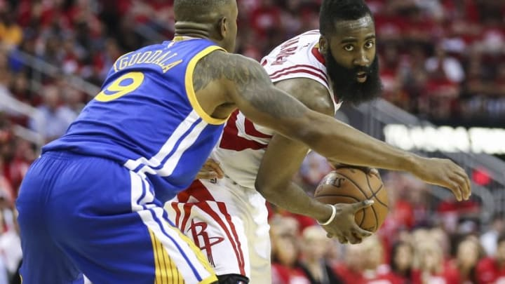 Apr 21, 2016; Houston, TX, USA; Houston Rockets guard James Harden (13) holds the ball as Golden State Warriors forward Andre Iguodala (9) defends during the fourth quarter in game three of the first round of the NBA Playoffs at Toyota Center. The Rockets won 97-96. Mandatory Credit: Troy Taormina-USA TODAY Sports