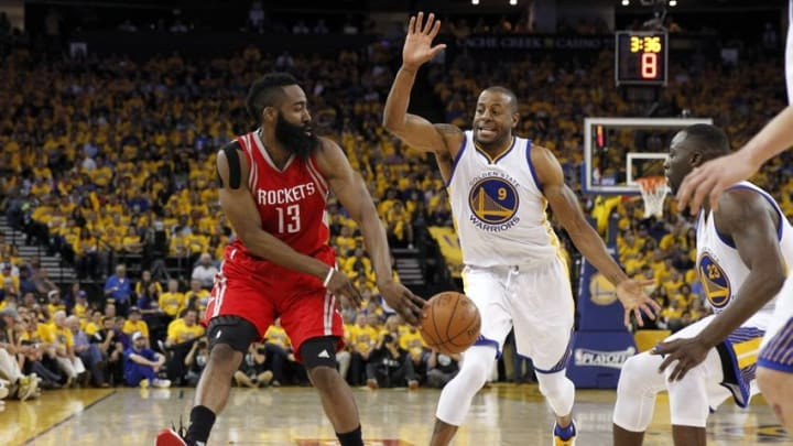 Apr 18, 2016; Oakland, CA, USA; Houston Rockets guard James Harden (13) passes the ball away from Golden State Warriors guard Andre Iguodala (9) in the second quarter in game two of the first round of the NBA Playoffs at Oracle Arena. Mandatory Credit: Cary Edmondson-USA TODAY Sports