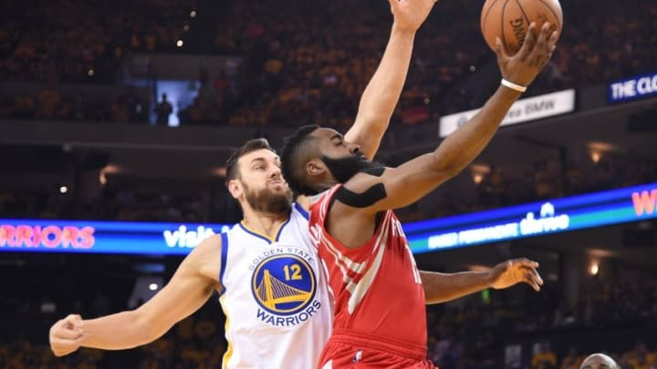 April 16, 2016; Oakland, CA, USA; Houston Rockets guard James Harden (13) shoots the basketball against Golden State Warriors center Andrew Bogut (12) during the first quarter in game one of the first round of the NBA Playoffs at Oracle Arena. Mandatory Credit: Kyle Terada-USA TODAY Sports