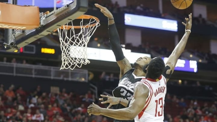 Dec 5, 2015; Houston, TX, USA; Sacramento Kings guard Ben McLemore (23) and Houston Rockets guard James Harden (13) compete for a rebound in the second half at Toyota Center. Rockets won 120-111. Mandatory Credit: Thomas B. Shea-USA TODAY Sports