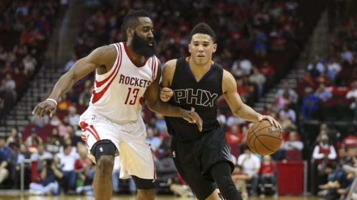Apr 7, 2016; Houston, TX, USA; Phoenix Suns guard Devin Booker (1) dribbles the ball as Houston Rockets guard James Harden (13) defends during the first quarter at Toyota Center. Mandatory Credit: Troy Taormina-USA TODAY Sports