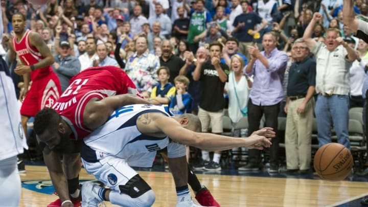 Apr 6, 2016; Dallas, TX, USA; Houston Rockets guard James Harden (13) fouls Dallas Mavericks guard Devin Harris (34) during the second half at the American Airlines Center. The Mavericks defeat the Rockets 88-86. Mandatory Credit: Jerome Miron-USA TODAY Sports