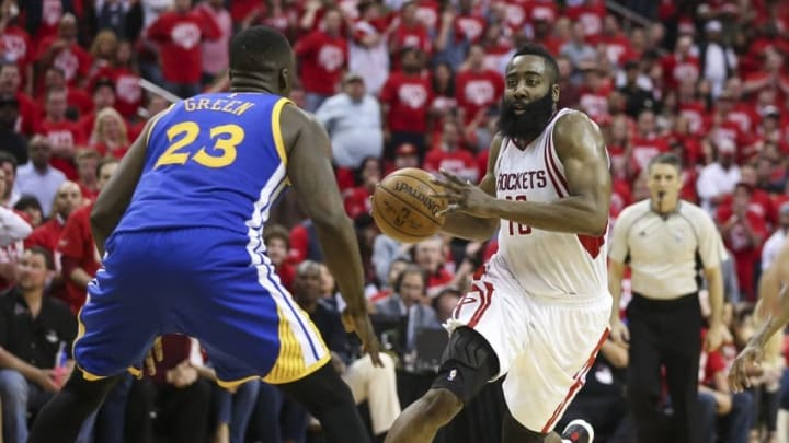 Apr 21, 2016; Houston, TX, USA; Houston Rockets guard James Harden (13) dribbles the ball as Golden State Warriors forward Draymond Green (23) defends during the fourth quarter in game three of the first round of the NBA Playoffs at Toyota Center. The Rockets won 97-96. Mandatory Credit: Troy Taormina-USA TODAY Sports