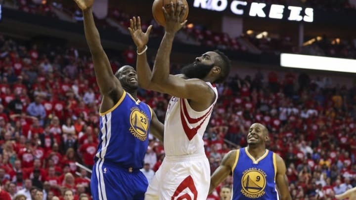 Apr 21, 2016; Houston, TX, USA; Houston Rockets guard James Harden (13) shoots the ball as Golden State Warriors forward Draymond Green (23) defends during the fourth quarter in game three of the first round of the NBA Playoffs at Toyota Center. The Rockets won 97-96. Mandatory Credit: Troy Taormina-USA TODAY Sports
