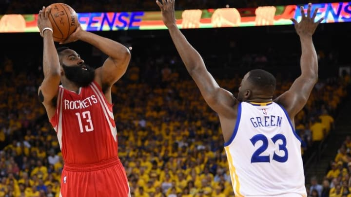 April 16, 2016; Oakland, CA, USA; Houston Rockets guard James Harden (13) shoots the basketball against Golden State Warriors forward Draymond Green (23) during the first quarter in game one of the first round of the NBA Playoffs at Oracle Arena. Mandatory Credit: Kyle Terada-USA TODAY Sports