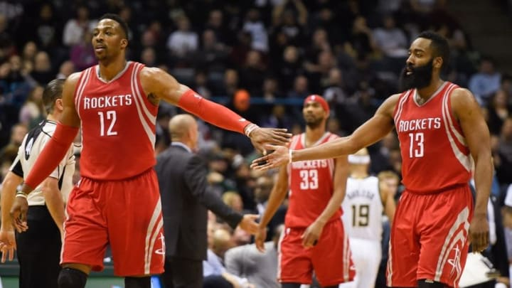Feb 29, 2016; Milwaukee, WI, USA; Houston Rockets center Dwight Howard (12) and guard James Harden (13) reacts after a basket in the fourth quarter during the game against the Milwaukee Bucks at BMO Harris Bradley Center. The Bucks beat the Rockets 128-121. Mandatory Credit: Benny Sieu-USA TODAY Sports