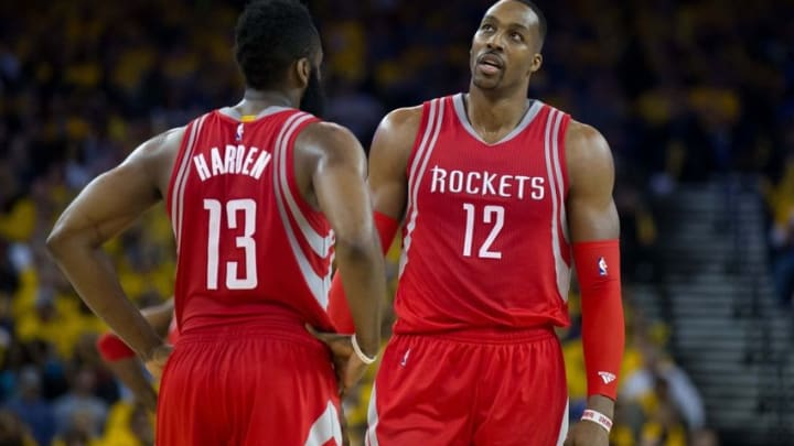 Apr 27, 2016; Oakland, CA, USA; Houston Rockets guard James Harden (13) and center Dwight Howard (12) between plays during the third quarter in game five of the first round of the NBA Playoffs at Oracle Arena. Mandatory Credit: Kelley L Cox-USA TODAY Sports