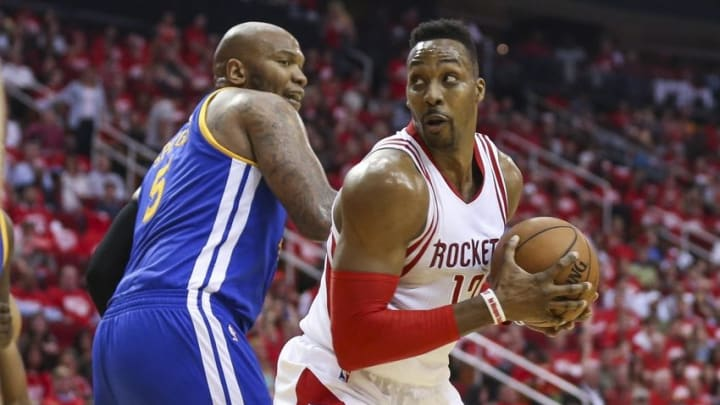 Apr 21, 2016; Houston, TX, USA; Houston Rockets center Dwight Howard (12) attempts to spin around Golden State Warriors center Marreese Speights (5) during the third quarter in game three of the first round of the NBA Playoffs at Toyota Center. The Rockets won 97-96. Mandatory Credit: Troy Taormina-USA TODAY Sports