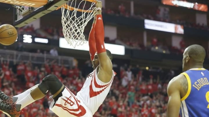 Apr 24, 2016; Houston, TX, USA; Houston Rockets center Dwight Howard (12) dunks against the Golden State Warriors in the second quarter in game four of the first round of the NBA Playoffs at Toyota Center. Mandatory Credit: Thomas B. Shea-USA TODAY Sports