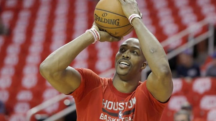 Apr 24, 2016; Houston, TX, USA; Houston Rockets center Dwight Howard (12) warms up before playing against the Golden State Warriors in game four of the first round of the NBA Playoffs at Toyota Center. Mandatory Credit: Thomas B. Shea-USA TODAY Sports