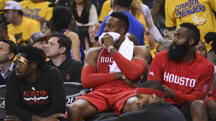 April 16, 2016; Oakland, CA, USA; Houston Rockets guard Patrick Beverley (2, left), center Dwight Howard (12, center), and guard James Harden (13, right) look on during the fourth quarter in game one of the first round of the NBA Playoffs against the Golden State Warriors at Oracle Arena. The Warriors defeated the Rockets 104-78. Mandatory Credit: Kyle Terada-USA TODAY Sports
