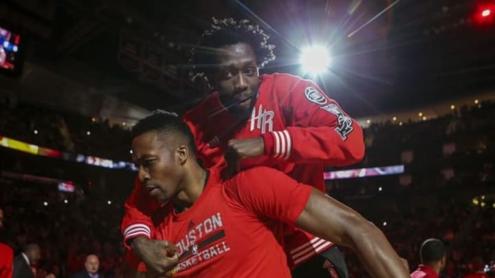 Apr 3, 2016; Houston, TX, USA; Houston Rockets guard Patrick Beverley (2) jumps on the back of center Dwight Howard (12) before a game against the Oklahoma City Thunder at Toyota Center. Mandatory Credit: Troy Taormina-USA TODAY Sports