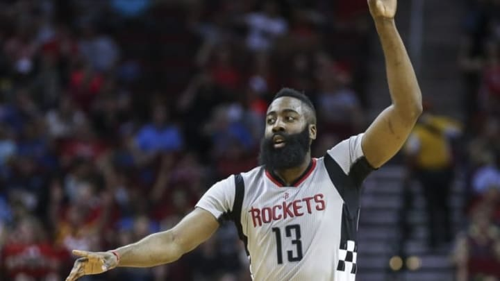 Apr 3, 2016; Houston, TX, USA; Houston Rockets guard James Harden (13) reacts after making a three point basket during the first quarter against the Oklahoma City Thunder at Toyota Center. Mandatory Credit: Troy Taormina-USA TODAY Sports