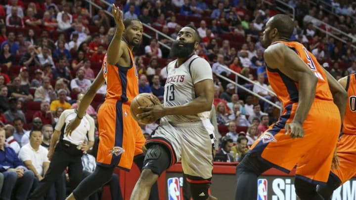 Apr 3, 2016; Houston, TX, USA; Houston Rockets guard James Harden (13) advances the ball to the basket during the second quarter against the Oklahoma City Thunder at Toyota Center. Mandatory Credit: Troy Taormina-USA TODAY Sports