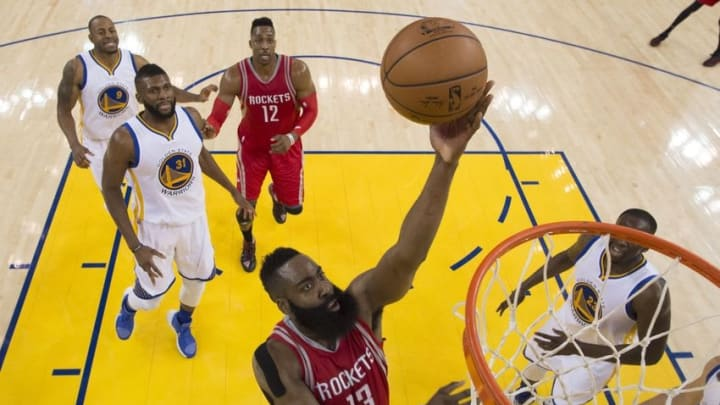 April 16, 2016; Oakland, CA, USA; Houston Rockets guard James Harden (13) shoots the basketball against the Golden State Warriors during the second half in game one of the first round of the NBA Playoffs at Oracle Arena. The Warriors defeated the Rockets 104-78. Mandatory Credit: Kyle Terada-USA TODAY Sports