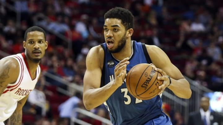 Mar 18, 2016; Houston, TX, USA; Minnesota Timberwolves center Karl-Anthony Towns (32) dribbles the ball during the second half against the Houston Rockets at Toyota Center. The Rockets won 116-111. Mandatory Credit: Troy Taormina-USA TODAY Sports