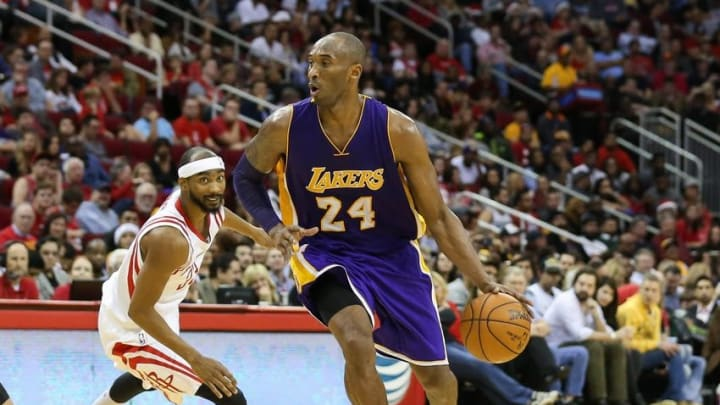 Dec 12, 2015; Houston, TX, USA; Los Angeles Lakers forward Kobe Bryant (24) dribbles the ball during a game against the Houston Rockets at Toyota Center. Mandatory Credit: Troy Taormina-USA TODAY Sports
