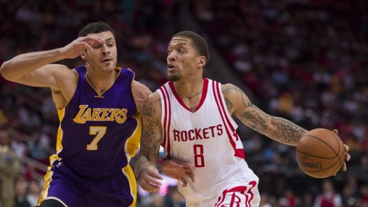 Apr 10, 2016; Houston, TX, USA; Los Angeles Lakers forward Larry Nance Jr. (7) defends against Houston Rockets forward Michael Beasley (8) during the first half at the Toyota Center. Mandatory Credit: Jerome Miron-USA TODAY Sports