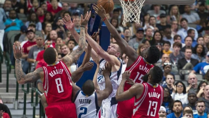Apr 6, 2016; Dallas, TX, USA; The Dallas Mavericks and the Houston Rockets fight for the loose ball during the second half at the American Airlines Center. The Mavericks defeat the Rockets 88-86. Mandatory Credit: Jerome Miron-USA TODAY Sports