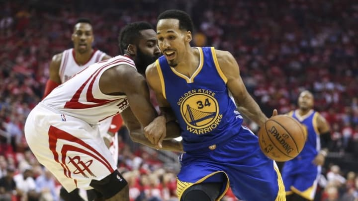 Apr 21, 2016; Houston, TX, USA; Golden State Warriors guard Shaun Livingston (34) dribbles the ball as Houston Rockets guard James Harden (13) defends during the second quarter in game three of the first round of the NBA Playoffs at Toyota Center. Mandatory Credit: Troy Taormina-USA TODAY Sports
