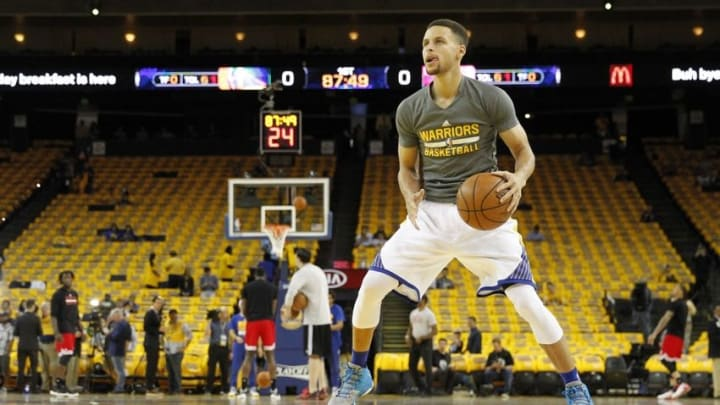 Apr 18, 2016; Oakland, CA, USA; Golden State Warriors guard Stephen Curry (30) dribbles the ball during warm ups before the start of the game against the Houston Rockets in game two of the first round of the NBA Playoffs at Oracle Arena. Mandatory Credit: Cary Edmondson-USA TODAY Sports