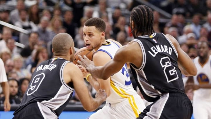 Apr 10, 2016; San Antonio, TX, USA; Golden State Warriors point guard Stephen Curry (30) is defended by San Antonio Spurs point guard Tony Parker (9) and small forward Kawhi Leonard (2) during the second half at AT&T Center. Mandatory Credit: Soobum Im-USA TODAY Sports