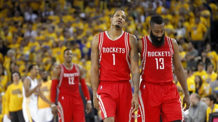 Apr 18, 2016; Oakland, CA, USA; Houston Rockets forward Trevor Ariza (1) and guard James Harden (13) walk down the court after the Rockets were called for a foul against the Golden State Warriors in the fourth quarter in game two of the first round of the NBA Playoffs at Oracle Arena. The Warriors defeated the Rockets 115-106. Mandatory Credit: Cary Edmondson-USA TODAY Sports