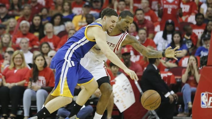 Apr 24, 2016; Houston, TX, USA; Golden State Warriors guard Klay Thompson (11) is defended by Houston Rockets forward Trevor Ariza (1) in the second quarter in game four of the first round of the NBA Playoffs at Toyota Center. Mandatory Credit: Thomas B. Shea-USA TODAY Sports